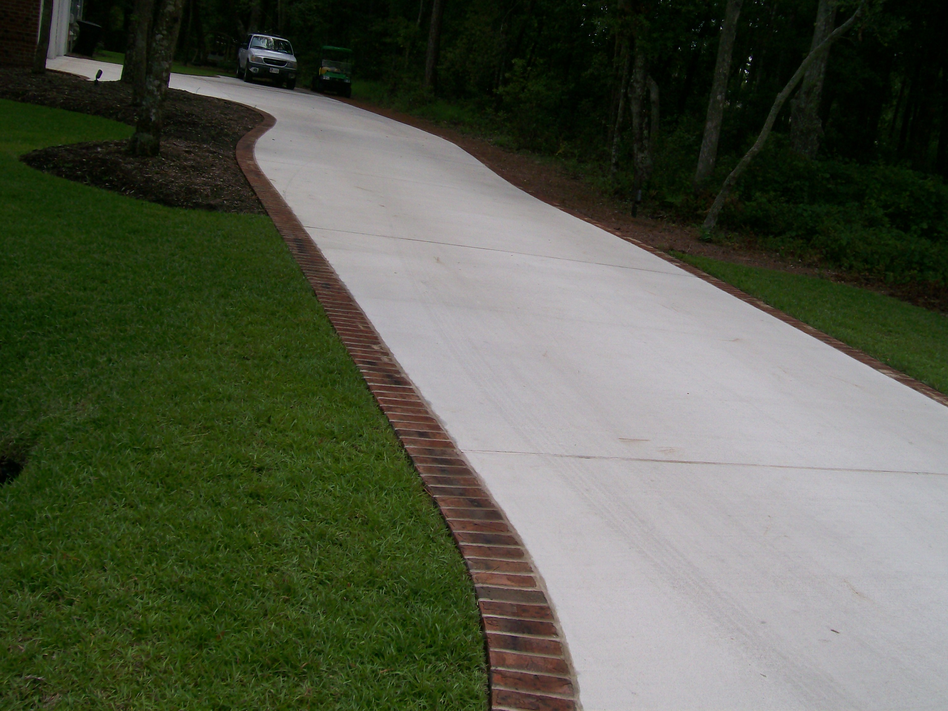 Broom finish paver border driveway and sidewalks for Brick sidewalk edging